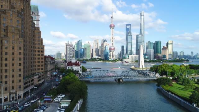 Drone shot: 4K Aerial view of Shanghai skyline in sunny sky. Shanghai, 2017, China - East Asia, Drone Shot, Aerial View, Cityscape, International Landmark shanghai stock videos & royalty-free footage