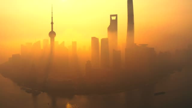 drone shot 4k aerial view of shanghai skyline with fog  pollution environmental problem view near the  oriental pearl tower in shanghai, china. - смог над городом стоковые видео и кадры b-roll
