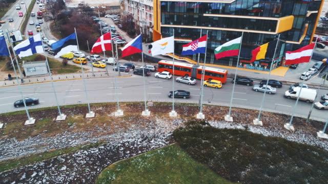drone shot aerial view of european union flags in sofia, bulgaria - valuta dell'unione europea video stock e b–roll