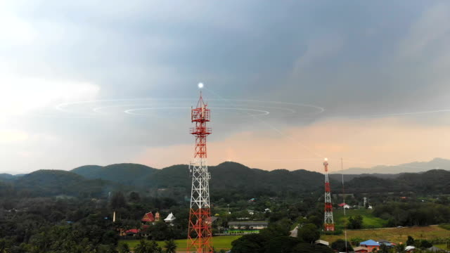 Drone shot aerial view scenic landscape of Communication tower with nature agriculture farm at rural countryside place