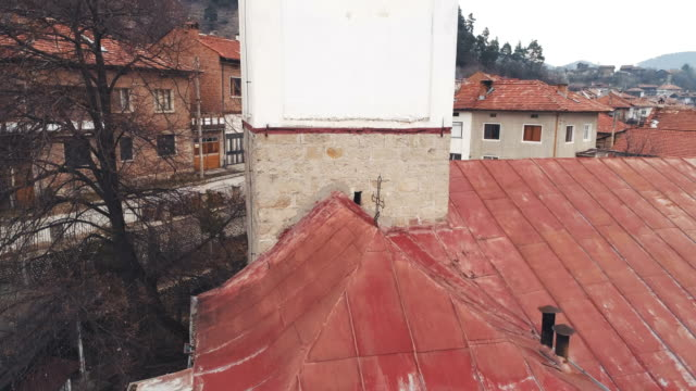 Drone shot ascending close to a church dome Drone shot ascending close to a church dome. The scene is situated near Bansko ski resort in Bulgaria (Eastern Europe) during wintery day. The footage was taken with DJI Phantom 4 Pro drone camera. eastern europe stock videos & royalty-free footage