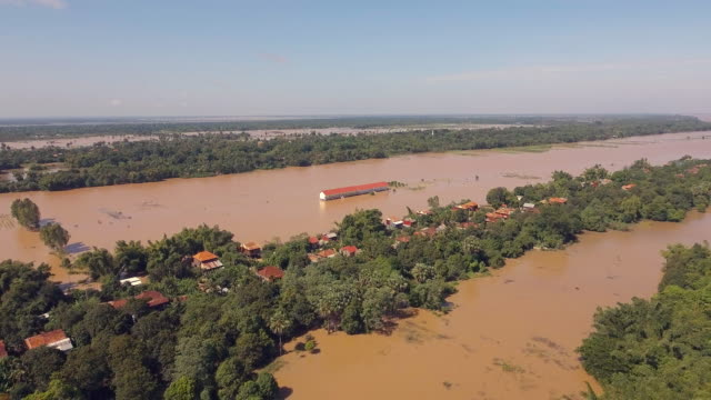 drone shot : fly backwards over tiny villages surrounded by flooded agricultural fields aerial drone shot : fly backwards over tiny villages surrounded by flooded agricultural fields back to back stock videos & royalty-free footage