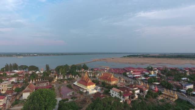 drone shot : flying back over Mekong riverside pagoda and buildings Aerial drone shot : flying back over Mekong riverside pagoda and buildings back to back stock videos & royalty-free footage