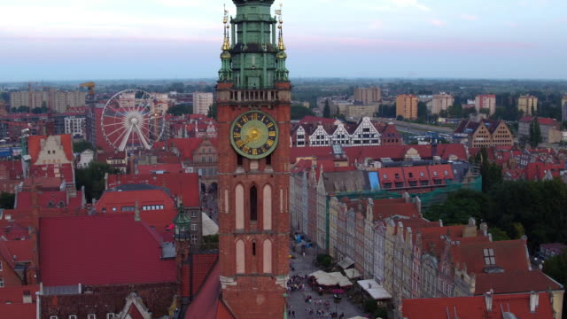 Drone shot in the afternoon in Gdansk old town. Romantic skyline, crowded street and ambient panorama, mannerist architecture, and historic Town Hall gdansk stock videos & royalty-free footage