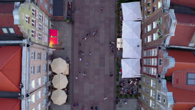 Drone shot in the evening picturing Long Lane in Gdansk. People sightseeing and relaxing in cafes and restaurants. gdansk stock videos & royalty-free footage