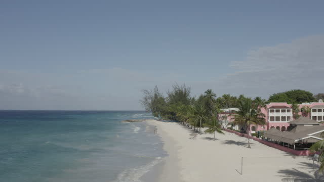 Drone shot moving out to sea over idyllic Caribbean beach (1) video
