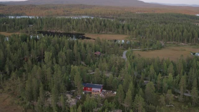 Drone shot of a cabin in the Norwegian woods