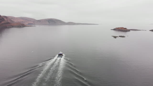 Drone shot of boat near Isle of Skye Aerial drone shot a boat taking tourists around Isle of Skye scotland stock videos & royalty-free footage