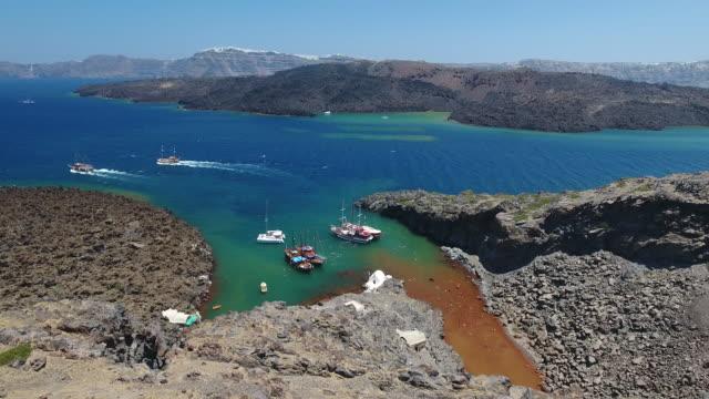 4k drone shot of boats near nea kameni island - isole egee video stock e b–roll
