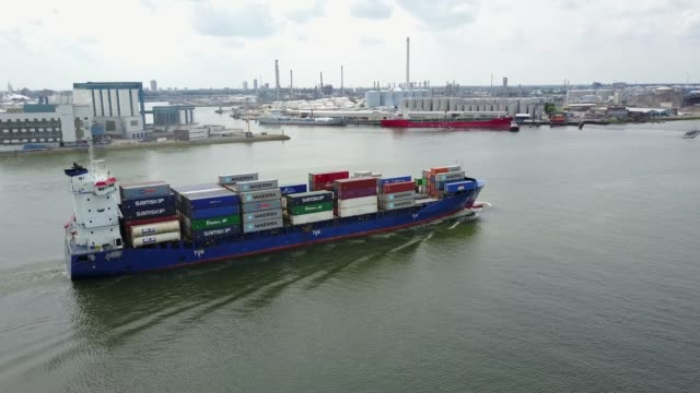 drone shot of cargo ship transporting containers in the dutch harbor of rotterdam 2 - rotterdam video stock e b–roll