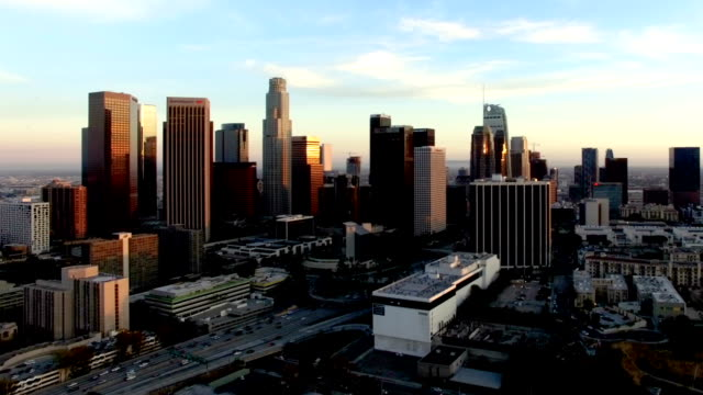 Drone shot of freeway traffic passing through downtown Los Angeles video