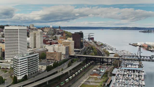 Drone Shot of Freight Train Passing Through Tacoma, Washington