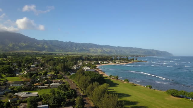 A Drone Shot of Haleiwa, Hawaii Fly towards the town of Haleiwa, Hawaii and the local mountains. oahu stock videos & royalty-free footage