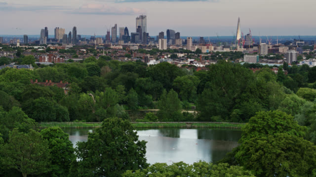 Drone Shot of Hampstead Ponds with London Skyline - Aerial