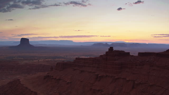 Drone Shot of Monument Valley and Surrounding Desert at Dusk - video