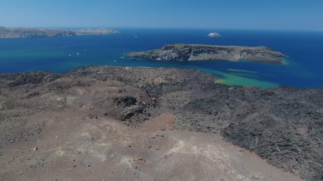 4k drone shot of nea kameni island - isole egee video stock e b–roll