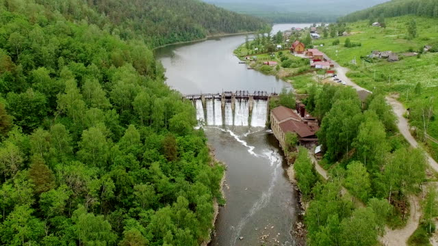Drone shot of river and dam video