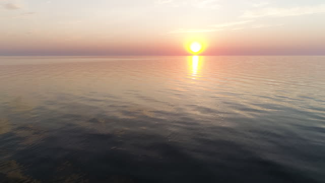 drone shot of sea during sunset - латвия стоковые видео и кадры b-roll