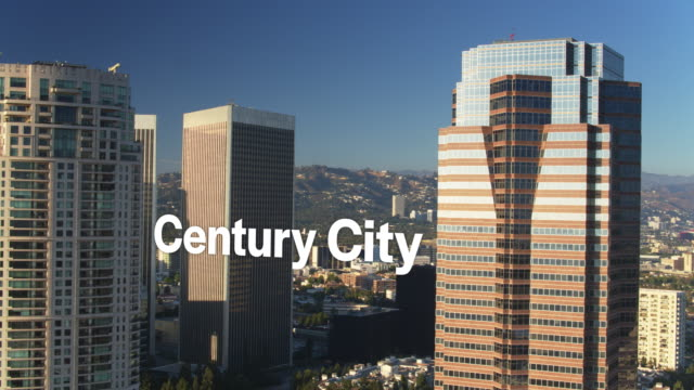 Drone Shot of Sun Shining on Skyscrapers with Floating Text: 'Century City' video