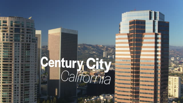Drone Shot of Sun Shining on Skyscrapers with Floating Text: 'Century City, California' video