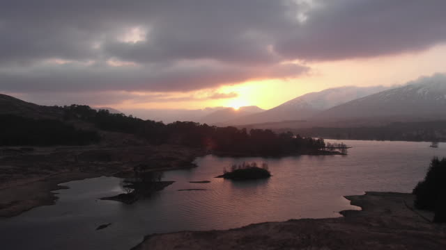 drone shot of sunset in highlands of scotland - glencoe lochaber video stock e b–roll