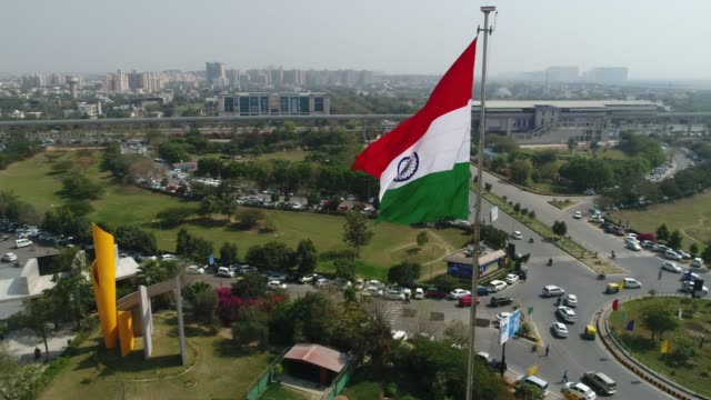 drone shot of the indian tricolour flag fluttering- wide shot (fast) - haryana video stock e b–roll