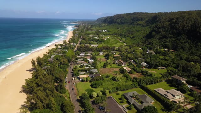 A Drone Shot of the North Shore of Oahu Fly over the North Shore of Oahu towards Pipeline on a beautiful sunny day. oahu stock videos & royalty-free footage