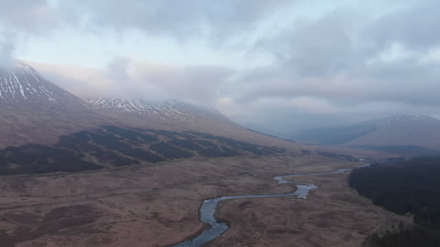 drone shot of valley in west highlands of scotland - glencoe lochaber video stock e b–roll