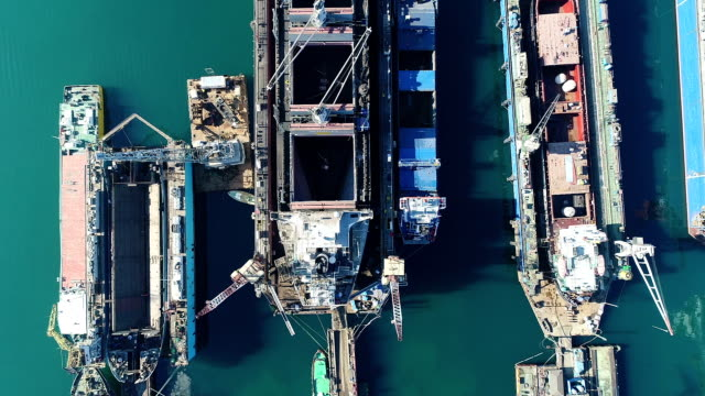 Drone Shot of Vessel at Dock top view Drone Shot of Vessel at Dock top view industrial ship stock videos & royalty-free footage