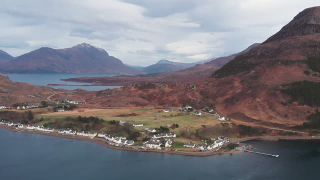 Drone shot of village Shieldaig Aerial drone shot of village Shieldaig in Wester Ross in Northwest Highlands of Scotland scotland stock videos & royalty-free footage