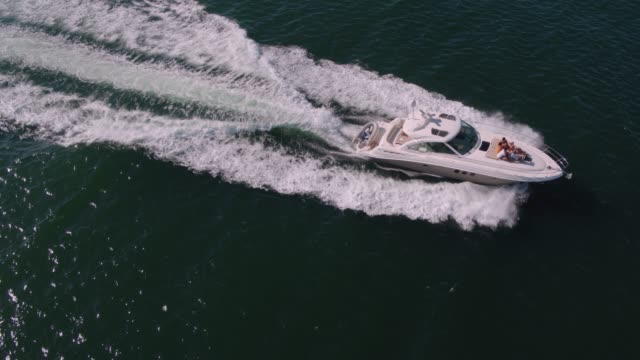 Drone shot of yacht sailing in the ocean