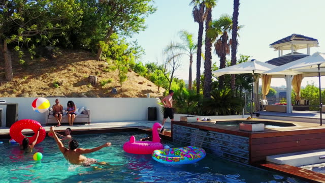 Drone Shot of Young People Partying in Pool video