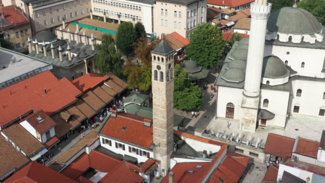 Drone shot Old watch tower and Gazi Husrev Baymosque from Ottoman period in the old part of Sarajevo Called