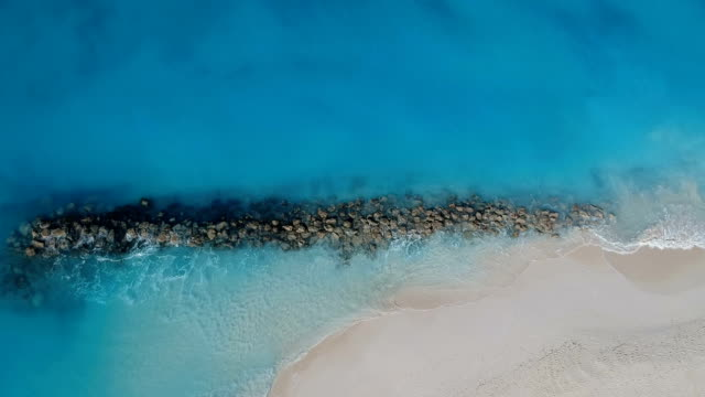 Drone stationary aerial of jetty in Grace Bay, Providenciales, Turks and Caicos Drone stationary aerial of pier in Grace Bay, Providenciales, Turks and Caicos turks and caicos islands stock videos & royalty-free footage