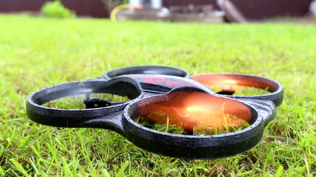 drone takes off from grass to shoot objects - telecomando background video stock e b–roll