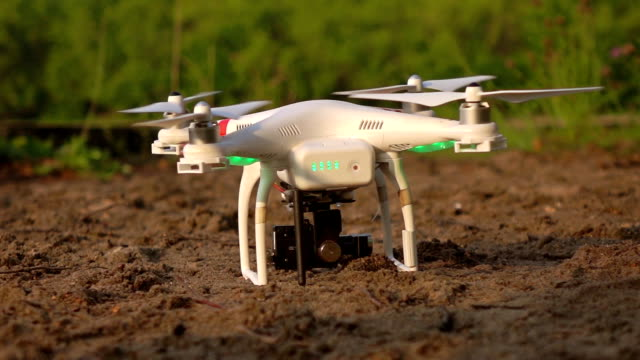 drone taking off from sand at sunset. super slow motion shot - dow jones industrial average video stock e b–roll