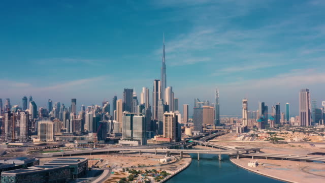 aerial. drone video of dubai city at day time. modern city concept vith transport and river. - dubai video stock e b–roll