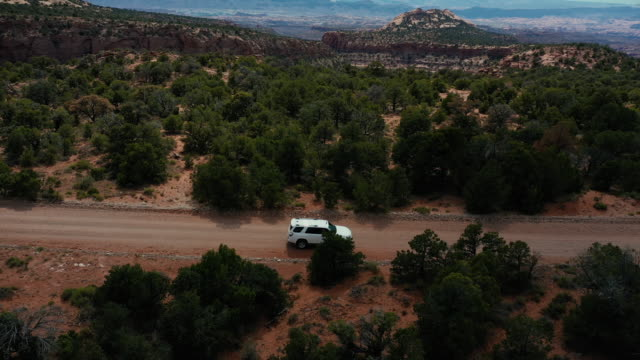Drone view: flying over a off road car at the Shafer trail Canyonlands