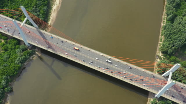 Drone view landscape highway bridge over river. Areal view city road landscape