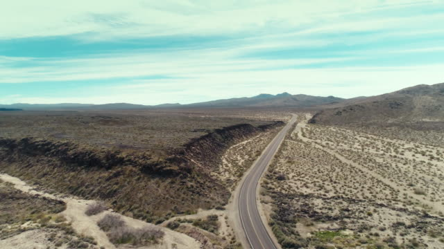 Drone view of a road through the mojave desert on a summer day