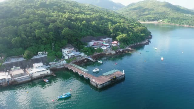 Drone view of A seascape of Ko Lau Wan Fishing village where is located in Sai Kung