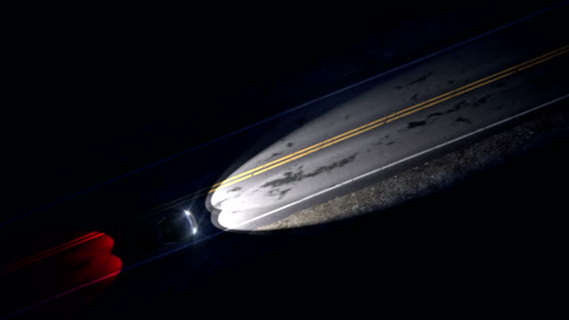 Drone view of car driving on a night country road with headlights, seamless loop Drone view of car driving on a night country road, seamless loop. Car drives with headlights and tail lights on lightening country one lane road with road markings and bumps. Seamless loop. country road stock videos & royalty-free footage