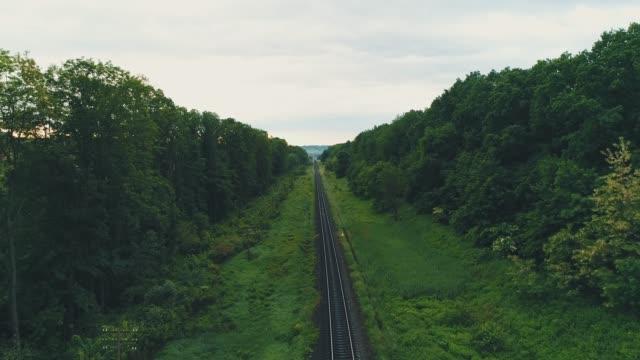 Drone view of empty straight single-way railways sunny summer day. 4K.