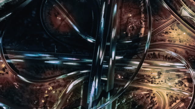 T/L ZO Drone View of Overpass and City Traffic at Night / Beijing, China