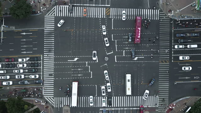 Drone View of Pedestrians Walking across with Crowded Traffic