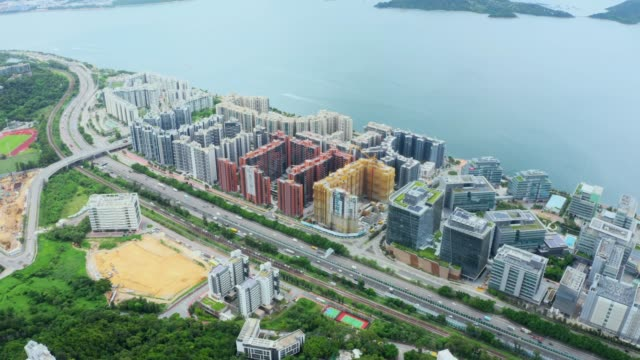 Drone view of residents building at Pak Shek Kok, Hong Kong Drone view of residents building at Pak Shek Kok, Hong Kong ocean front properties stock videos & royalty-free footage