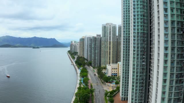 Drone view of residents building in Ma On Shan, Hong Kong Drone view of residents building in Ma On Shan, Hong Kong ocean front properties stock videos & royalty-free footage