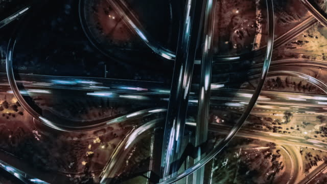 T/L PAN Drone View of Road Intersection at Night Aerial View of Overpass and City Traffic at Night / Beijing, China cycle vehicle stock videos & royalty-free footage