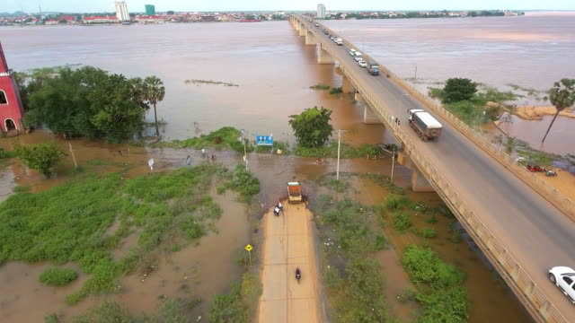 drone view of traffic on the bridge over the flooded Mekong River video