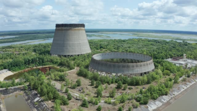 drone view of two giant cooling towers, chernobyl - reattore nucleare video stock e b–roll